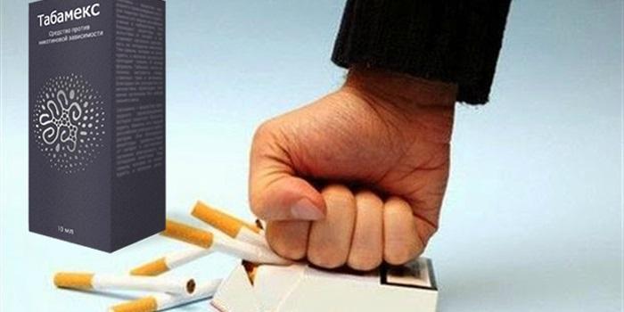 коробка Табамекс кулак давит пачку сигарет